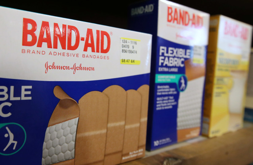 Johnson & Johnson band-aids sit on a shelf at the Rock Canyon Pharmacy, in Provo, Utah on May 9, 2019. (photo credit: GEORGE FREY/ REUTERS)