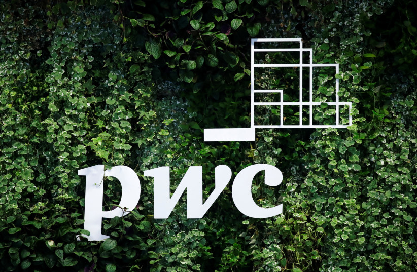 The logo of accounting firm PricewaterhouseCoopers (PwC) is seen on a board at the St. Petersburg International Economic Forum (SPIEF), Russia (photo credit: REUTERS/MAXIM SHEMETOV)