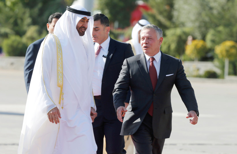 Abu Dhabi's Crown Prince Sheikh Mohammed bin Zayed al-Nahyan meets with Jordan's King Abdullah at Amman military airport, Jordan, November 20, 2018 (photo credit: REUTERS/MUHAMMAD HAMED)