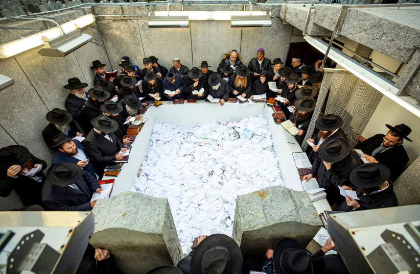 CHABAD RABBIS pay their respects at the Rebbe's resting place in November 2019. (photo credit: MENDEL GROSSBAUM/CHABAD.ORG)