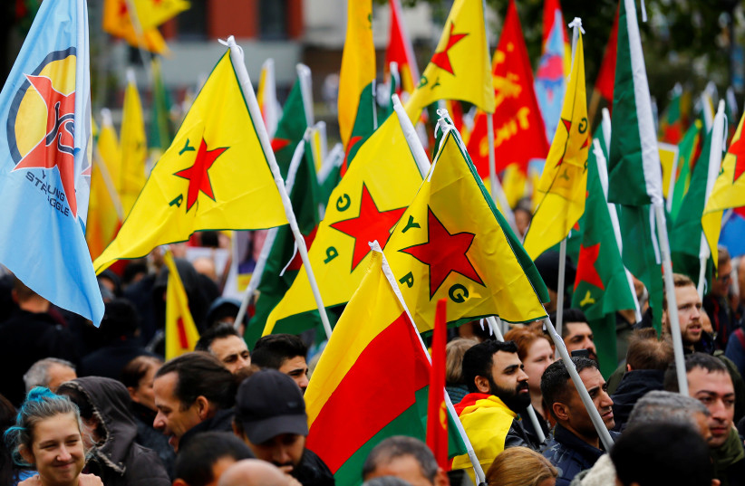 Pro-Kurdish demonstrators protest against Turkey's military action in northeastern Syria in Cologne, Germany, October 19, 2019 (photo credit: THILO SCHMUELGEN/REUTERS)