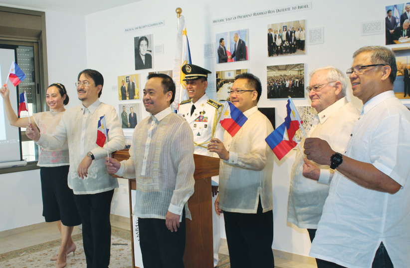 RAISING THE flag ceremony on Philippines Independence Day. (photo credit: COURTESY PHILIPPINES EMBASSY)