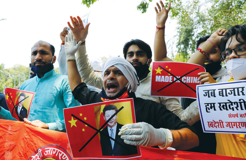 ACTIVISTS SHOUT slogans during a protest against China, in New Delhi on Wednesday. (photo credit: REUTERS/ANUSHREE FADNAVIS)
