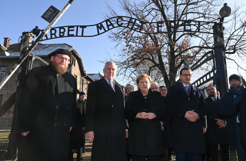 "On December 6, 2019, in front of the notorious gate at the site of the former Auschwitz- Birkenau concentration and extermination camp marked ""Arbeit Macht Frei"" (Work Sets You Free), from  left to right: Piotr M.A. Cywinski, Director of the Auschwitz-Birkenau State Museum and President of the Ausch (photo credit: SHAHAR AZRAN / WJC)"