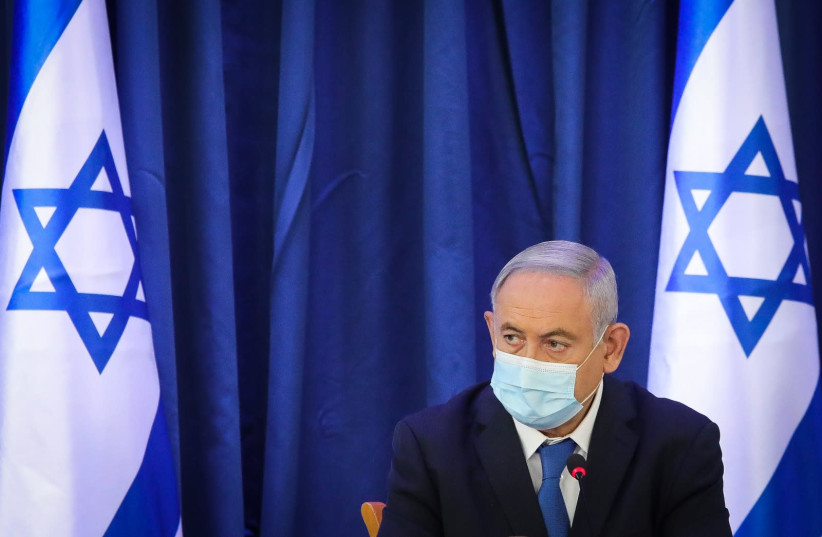 Prime Minister Benjamin Netanyahu attends the weekly cabinet meeting (photo credit: MARC ISRAEL SELLEM)