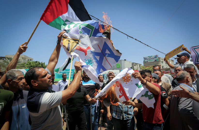 The Palestinians participate in a march rejecting the policy of the Israeli annexation project in the West Bank and the Jordan Valley and the deal of the century, in Rafah in the southern Gaza Strip, on June 11, 2020. (photo credit: ABED RAHIM KHATIB/FLASH90)