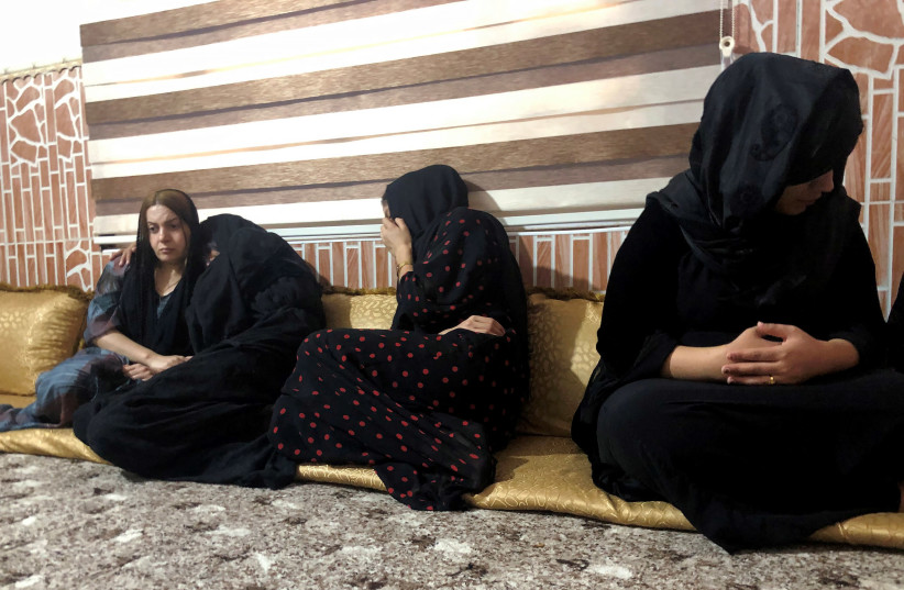 Women mourn the death of a man who was killed in a Turkish airstrikes in Sheladize in the north of Dohuk province, close to the Turkish border, Iraq June 22, 2020. (photo credit: REUTERS/KAWA OMAR)