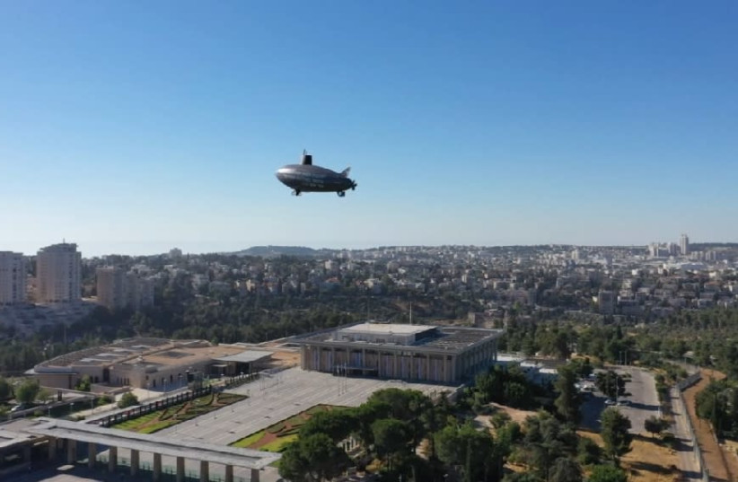 A Zeppelin in seen above the Knesset, protesting Prime Minister Benjamin Netanyahu's submarine affair (photo credit: NOAM MOSKOWITZ)