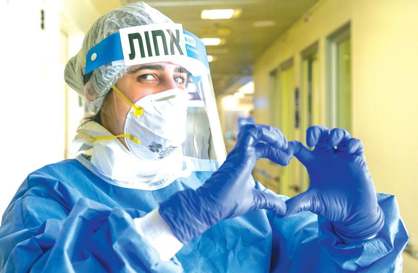 A MEDICAL worker at the coronavirus unit, in Tel Aviv Sourasky Medical Center (Ichilov) hospital last month. (photo credit: YOSSI ALONI/FLASH90)