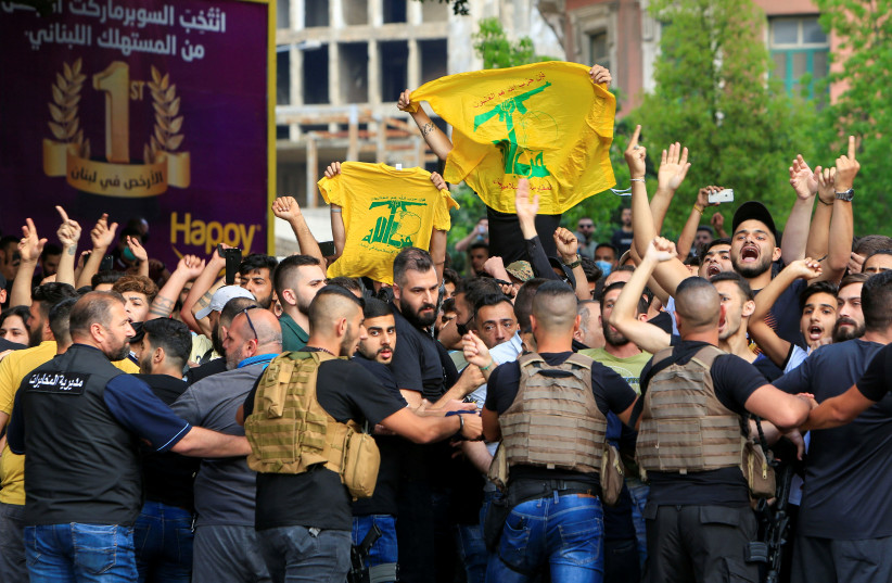 Lebanese army try to block supporters of the Lebanese Shi'ite groups Hezbollah and Amal as they gesture and chant slogans against anti-government demonstrators, in Beirut (photo credit: REUTERS)