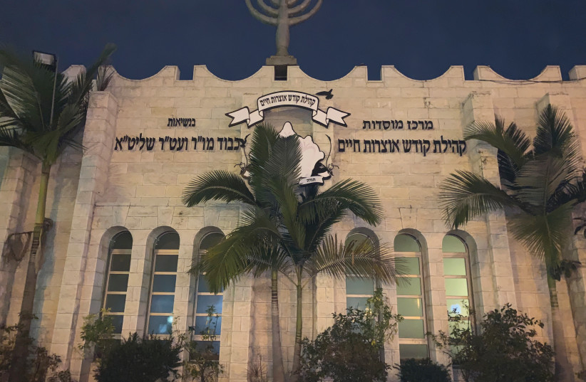 THE GLOWING Yismach Moshe Synagogue at night, a major religious center of Ashdod's Moroccan Jewry. (photo credit: JACOB SOLOMON)