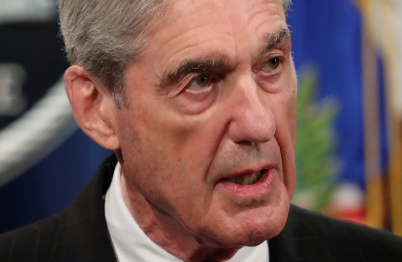 FORMER US special counsel Robert Mueller discusses Russian interference in the 2016 US presidential election. (photo credit: REUTERS/JIM BOURG)