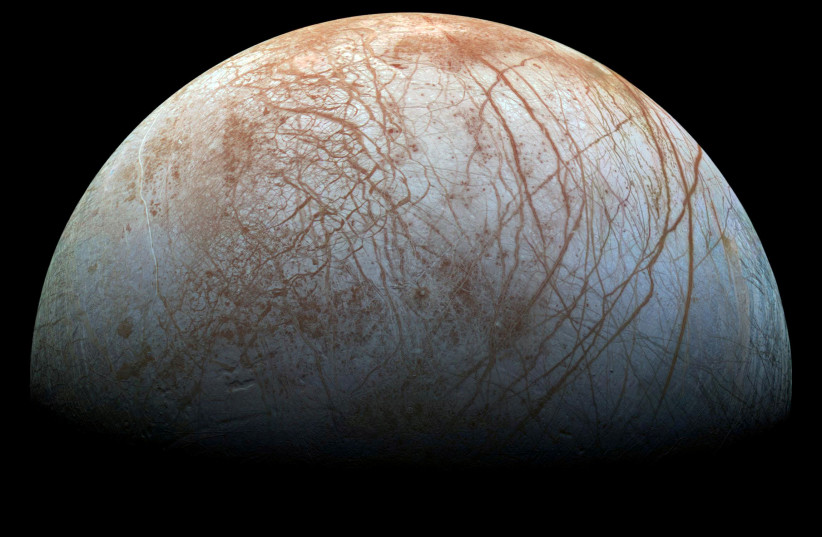 A view of Jupiter's moon Europa created from images taken by NASA's Galileo spacecraft in the late 1990's, according to NASA, obtained by Reuters May 14, 2018. (photo credit: REUTERS)