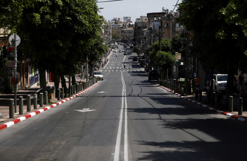 A general view shows a street in Bnei Brak as Israel enforces a lockdown, April 3, 2020 (photo credit: AMMAR AWAD/REUTERS)