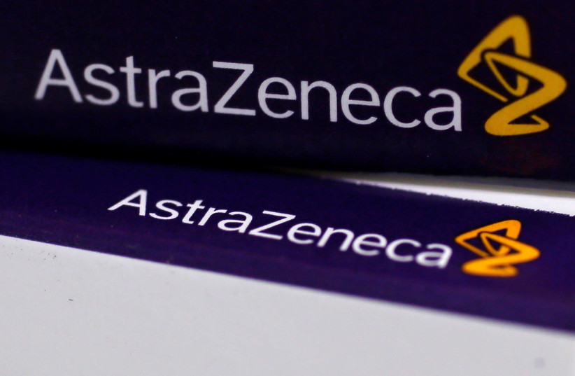 The logo of AstraZeneca is seen on medication packages in a pharmacy in London (photo credit: REUTERS)