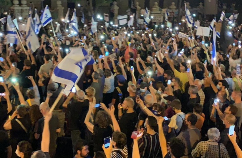 Black Flags demonstrators protesting the arrest of brig.-gen. (res.) Amir Haskel and calling on Prime Minister Benjamin Netanyahu to resign. (photo credit: BLACK FLAGS MOVEMENT)
