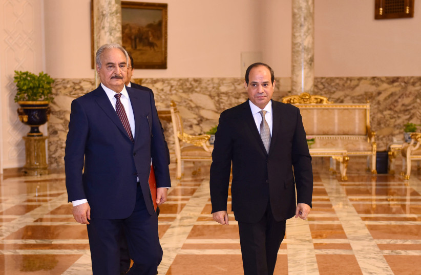 LIBYAN MILITARY commander Khalifa Haftar (left) walks with Egyptian President Abdel Fattah al-Sisi at the Presidential Palace in Cairo in April 2019. (photo credit: REUTERS)