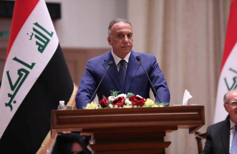 Iraqi Prime Minister Mustafa al-Kadhimi delivers a speech during the vote on the new government at the parliament headquarters in Baghdad, Iraq, May 7, 2020 (photo credit: IRAQI PARLIAMENT MEDIA OFFICE/HANDOUT VIA REUTERS)