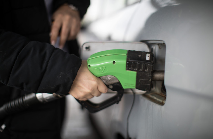 Filling gas tank of car, illustrative  (photo credit: HADAS PARUSH/FLASH90)