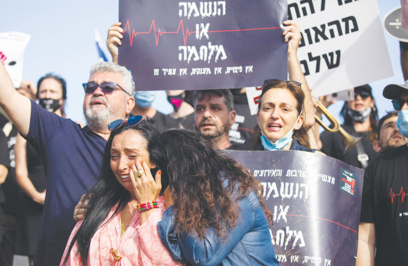Workers protest outside the Finance Ministry in Jerusalem, June 2020 (photo credit: YONATAN SINDEL/FLASH90)