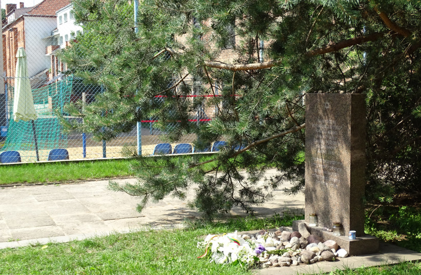 A memorial at the site of the Lietukis Garage massacre of Jewish Men in Kaunas, Lithuania. (photo credit: FLICKR/ADAM JONES)