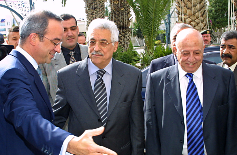 Jordanian official Marwan Muasher (L) welcomes Palestinian leader Mahmoud Abbas (C) and Palestinian Prime Minister Ahmed Qurie on their arrival in Amman 29, 2004. (photo credit: REUTERS/MAJED JABER AJ)
