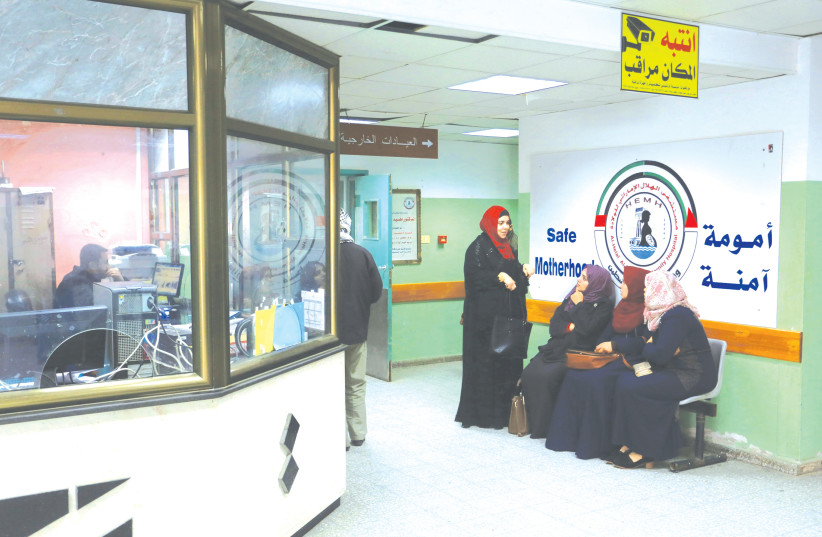 PALESTINIAN PATIENTS wait in the Crescent UAE Hospital in the southern Gaza Strip. (photo credit: ABED RAHIM KHATIB/FLASH90)