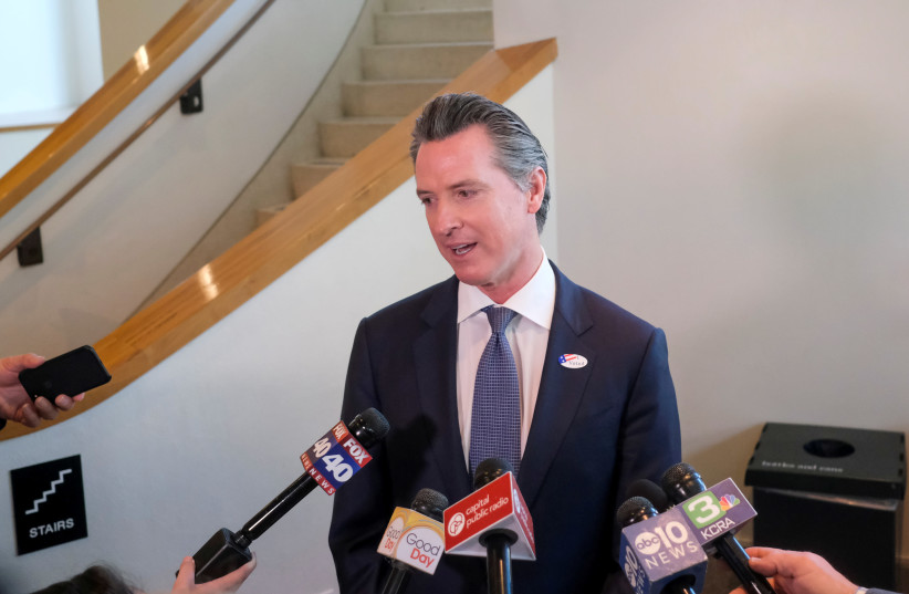 California's Governor Gavin Newsom speaks to the media after casting his vote at a voting center at The California Museum for the presidential primaries on Super Tuesday in Sacramento, CA, U.S., March 3, 2020 (credit: REUTERS/GABRIELA BHASKAR/FILE PHOTO)