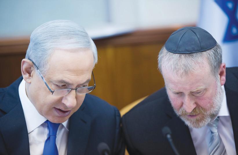 PRIME MINISTER Benjamin Netanyahu and Attorney-General Avichai Mandelblit talk at the Prime Minister's Office in Jerusalem in 2015. (photo credit: YONATAN SINDEL/FLASH 90)