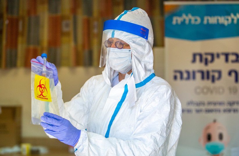 Health care workers take test samples to check for coronavirus, Lod, July 5, 2020 (photo credit: YOSSI ALONI/FLASH90)