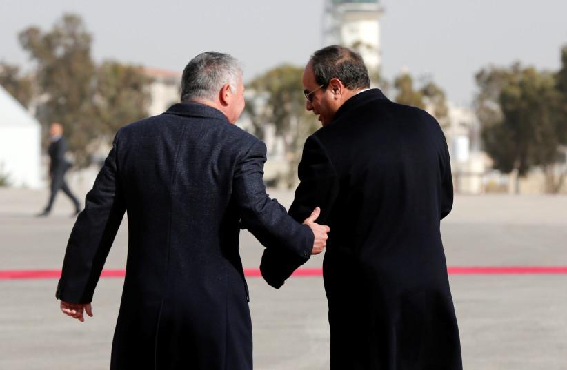 Jordan's King Abdullah welcomes Egyptian President Abdel Fattah al-Sisi at Amman airport (photo credit: MUHAMMAD HAMED/REUTERS)