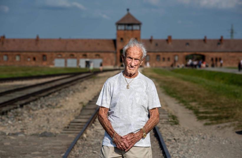 Holocaust Survivor Edward Mosberg outside Birkenau. (photo credit: WWW.FROMTHEDEPTHS.ORG)