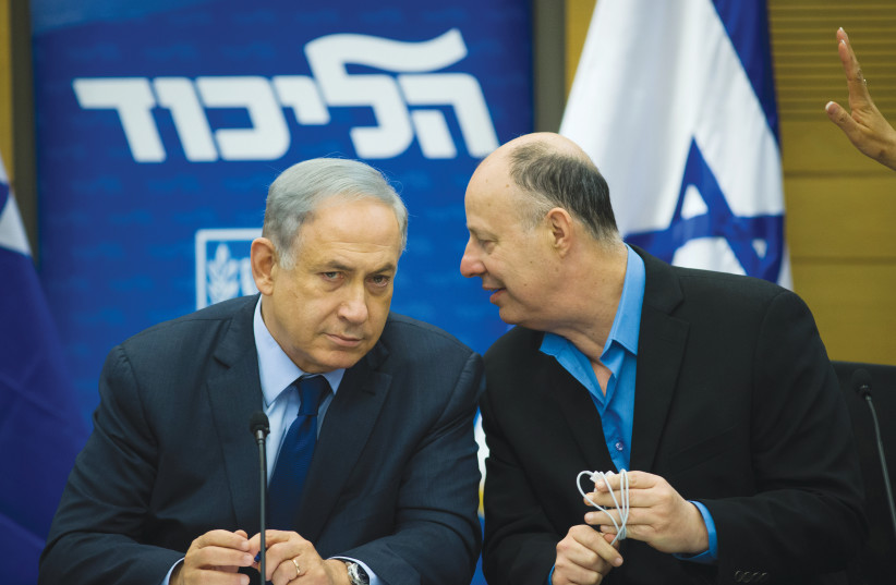 CURRENT MINISTER-without-Portfolio Tzachi Hanegbi catches the ear of Prime Minister Benjamin Netanyahu in the Knesset in 2016. (photo credit: YONATAN SINDEL/FLASH 90)