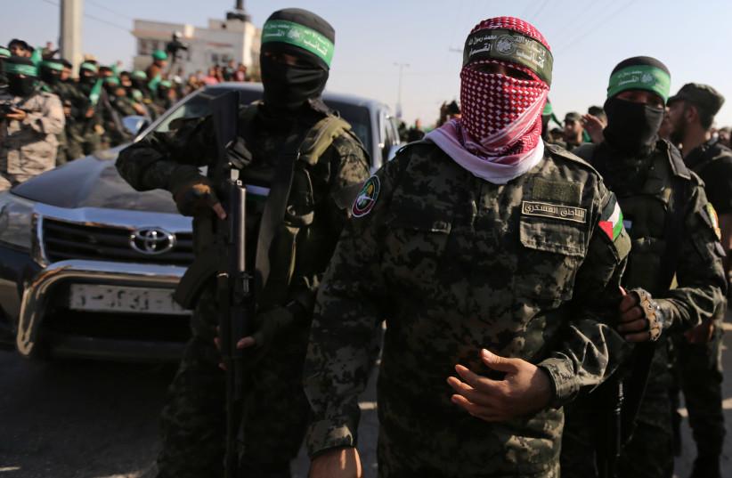 Abu Ubaida, the spokesman of the Izz el-Deen al-Qassam Brigades, walks during an anti-Israel military show by Hamas militants in the southern Gaza Strip (photo credit: IBRAHEEM ABU MUSTAFA/REUTERS)
