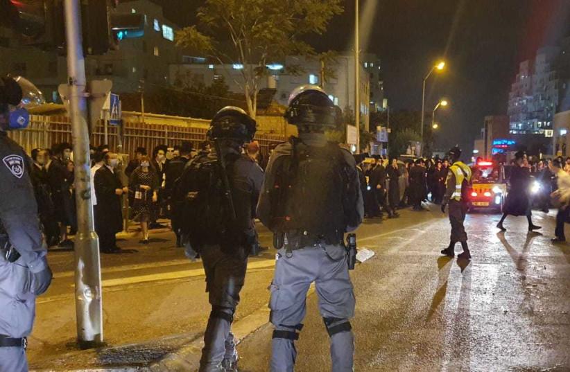 Haredim, police clash over coronavirus lockdown in Jerusalem