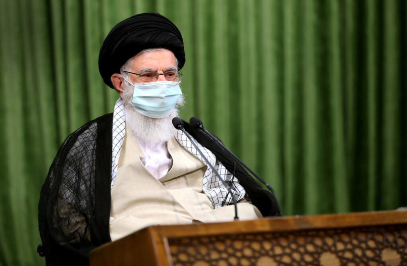 Iran's Supreme Leader Ayatollah Ali Khamenei wears a protective face mask, during a virtual meeting with lawmakers in Tehran (photo credit: REUTERS)