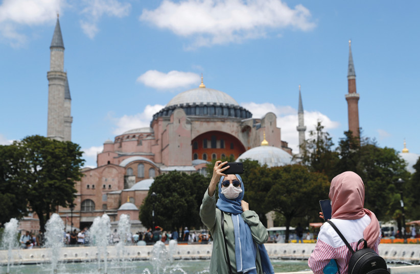 POSING FOR a selfie in front of Hagia Sophia in Istanbul, Turkey, on July 11 (photo credit: MURAD SEZER/REUTERS)