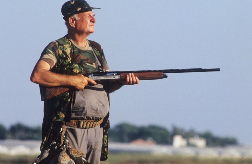 A hunter surveys the landscape (photo credit: EYAL BARTOV)
