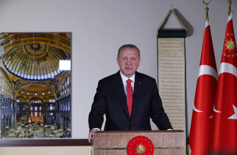 Turkish President Tayyip Erdogan, with a picture of Hagia Sophia or Ayasofya in the background, delivers a televised address to the nation in Ankara, Turkey, July 10, 2020 (photo credit: TURKISH PRESIDENTIAL PRESS OFFICE/VIA REUTERS)