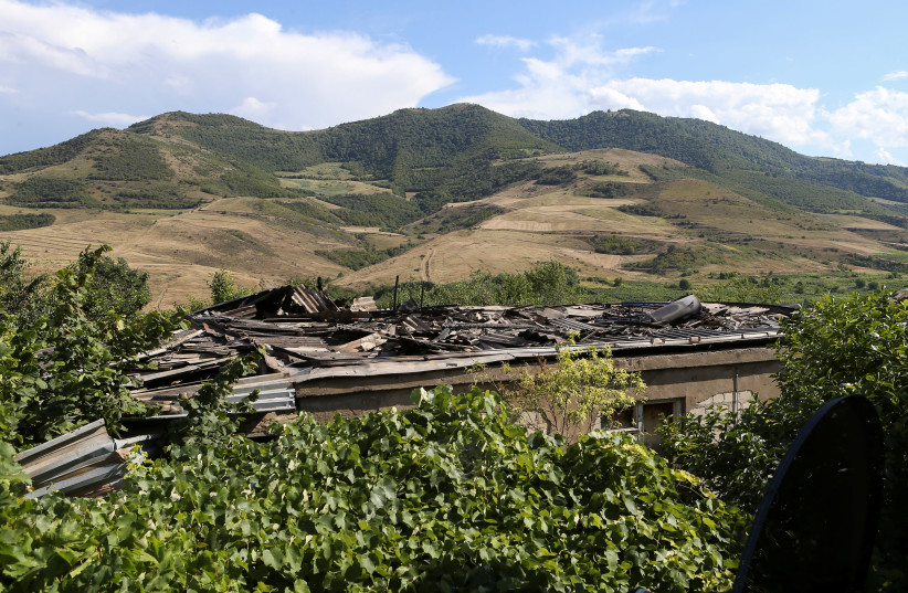 A view shows a house damaged by a recent shelling in armed clashes on the border between Azerbaijan and Armenia (photo credit: REUTERS)