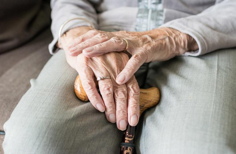 Elderly hand (illustrative) (photo credit: PIXABAY)