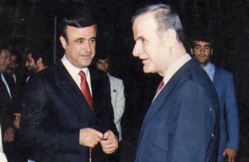 Rifaat al-Assad with his brother, former Syrian president Hafez al-Assad (photo credit: Wikimedia Commons)