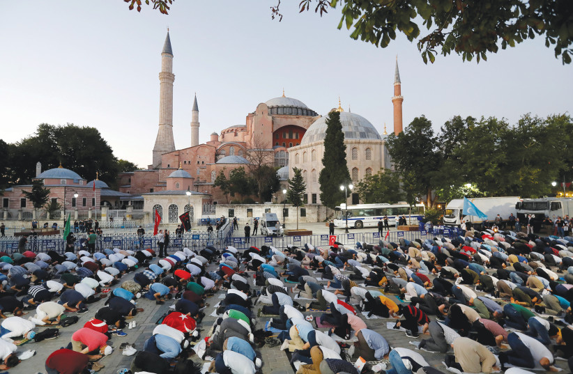MUSLIMS PRAY in front of the Hagia Sophia in Istanbul earlier this month. (photo credit: MURAD SEZER/REUTERS)