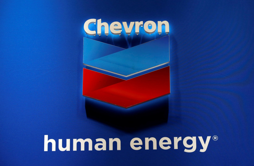 The logo of Chevron Corp is seen in its booth at Gastech, the world's biggest expo for the gas industry, in Chiba, Japan April 4, 2017 (photo credit: REUTERS/TORU HANAI)