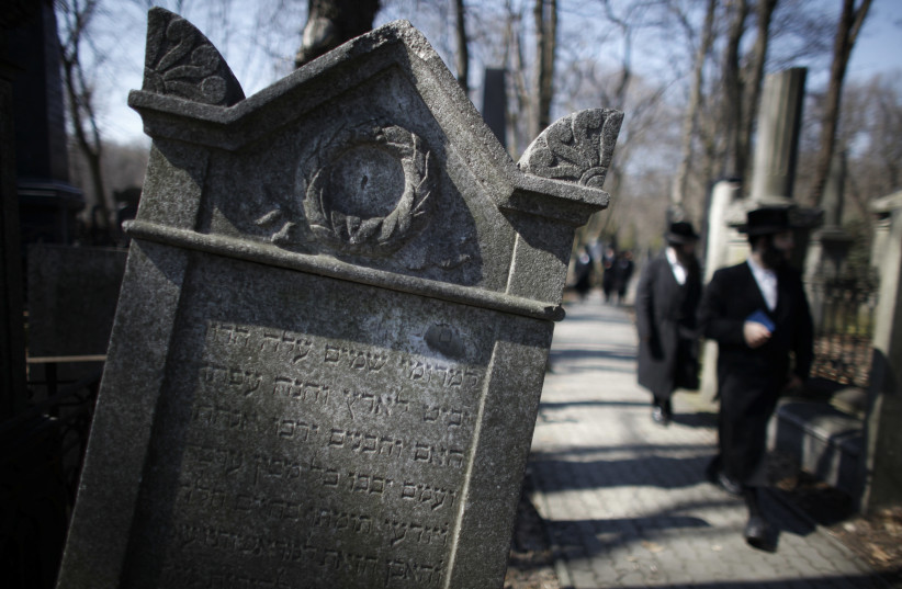 An Orthodox Jew walks through the Jewish Cemetery in Warsaw April 15, 2013. The 70th anniversary of the Warsaw Ghetto Uprising will be commemorated on April 19, 2013. Picture taken April 15, 2013. (photo credit: REUTERS)