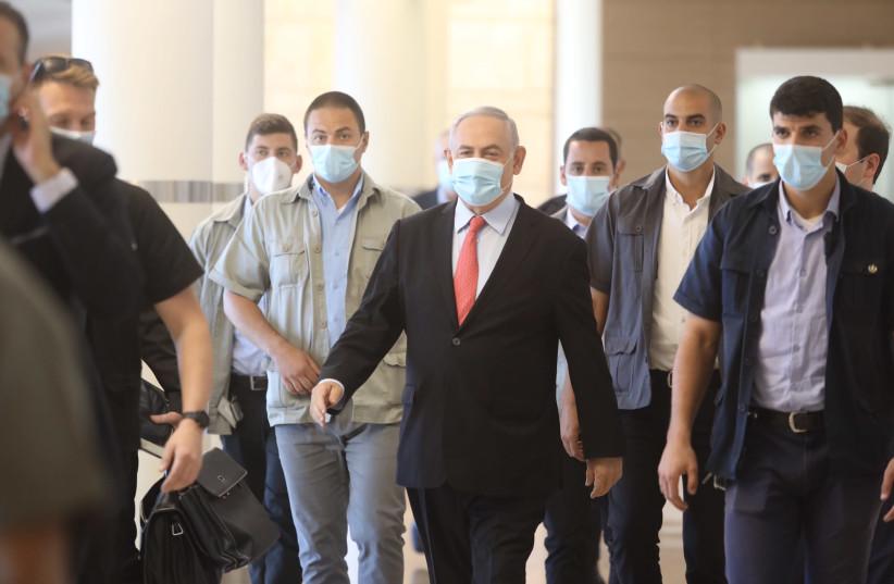 Prime Minister Benjamin Netanyahu wearing a medical mask amid coronavirus pandemic (photo credit: MARC ISRAEL SELLEM)