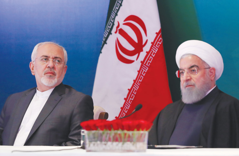 IRANIAN PRESIDENT Hassan Rouhani (right) and Foreign Minister Javad Zarif. Who wanted to pay the price of moral action to truly stop Iran? (photo credit: DANISH SIDDIQUI/ REUTERS)