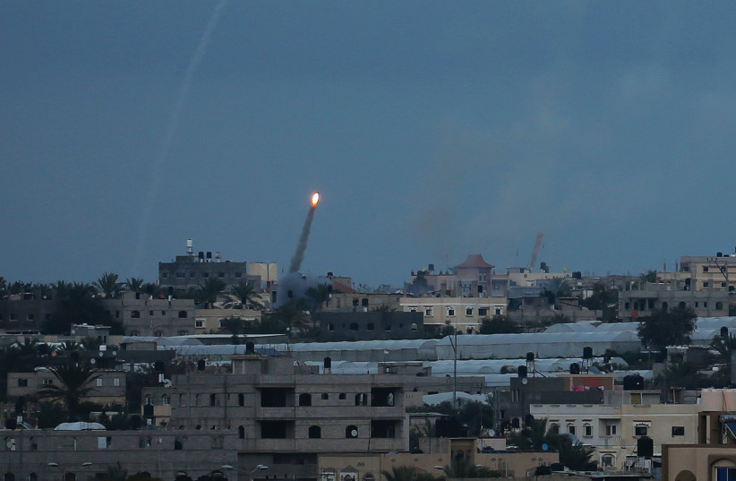 A ROCKET IS fired toward Israel from the southern Gaza Strip in February. (photo credit: IBRAHEEM ABU MUSTAFA / REUTERS)