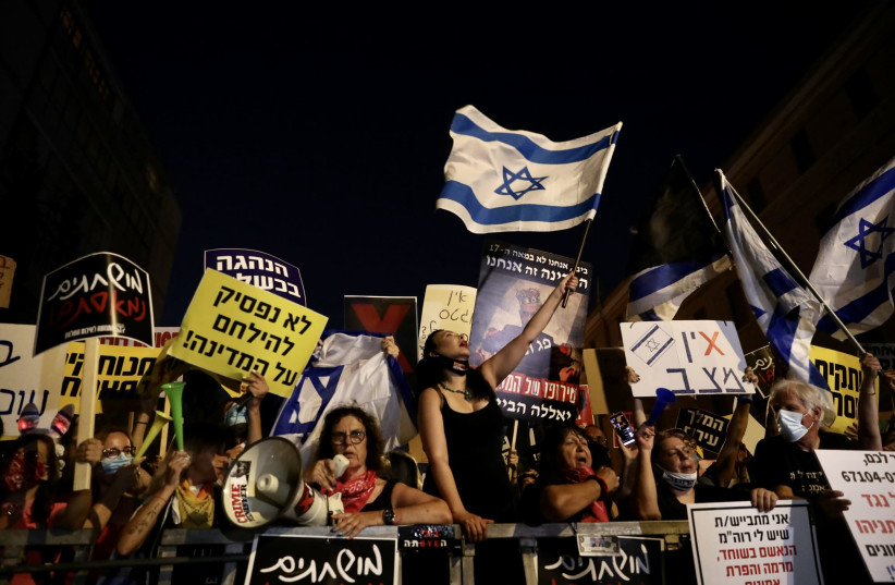 Protesters gather out the Prime Minister's Residence to protest Prime Minister Benjamin Netanyahu's COVID-19 response and the ongoing financial difficulties it has caused, July 23, 2020 (photo credit: MARC ISRAEL SELLEM/THE JERUSALEM POST)