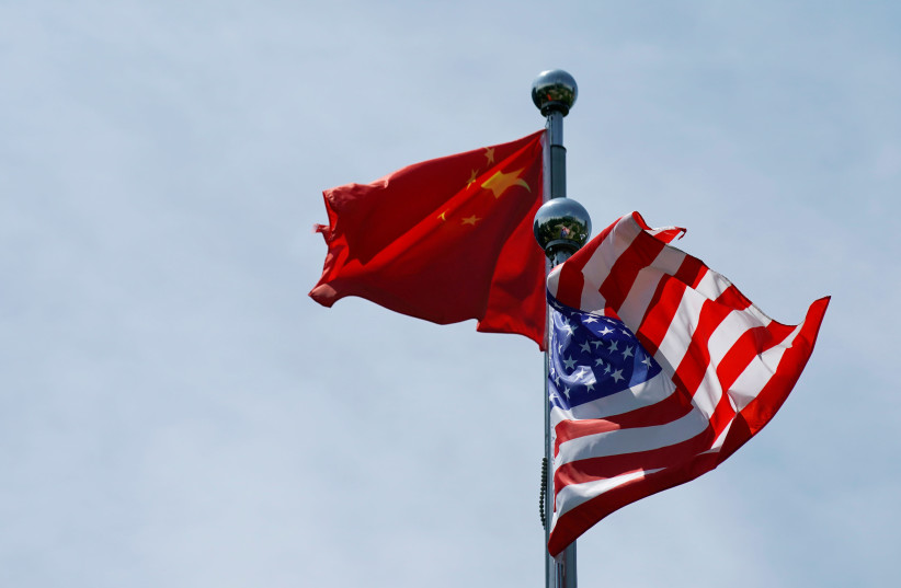 Chinese and US flags flutter before a trade meeting in Shanghai, China July 30, 2019 (photo credit: REUTERS/ALY SONG)